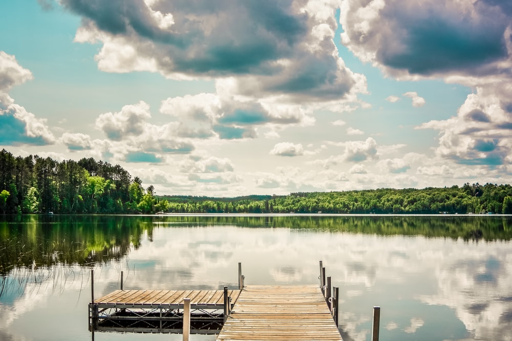 landscape photography of lake dock