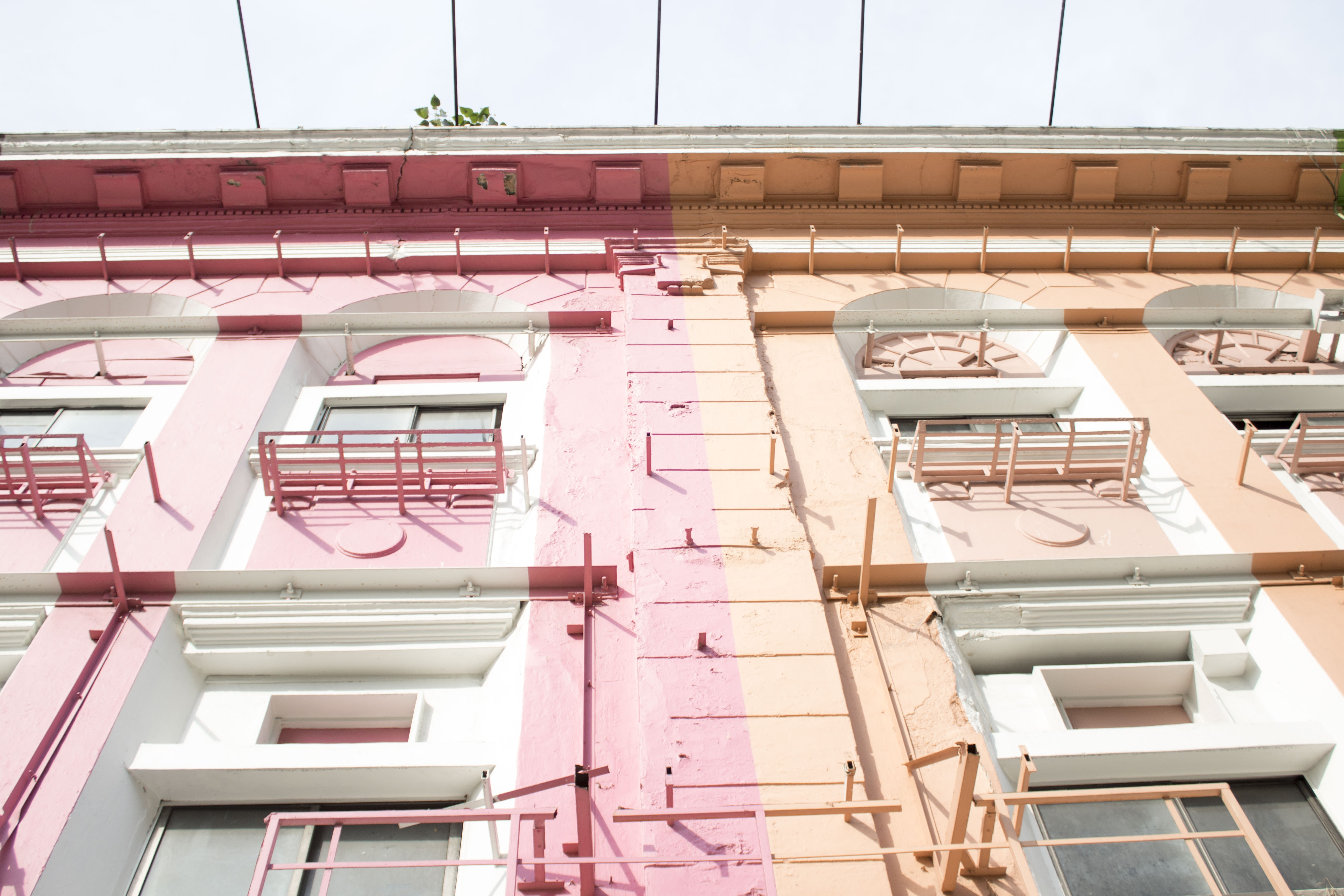 pink and orange painted building