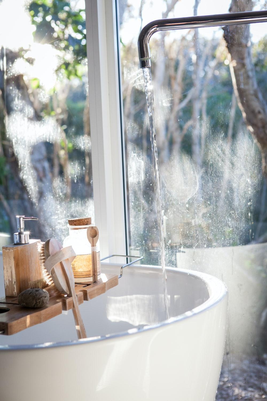 white ceramic sink beside window