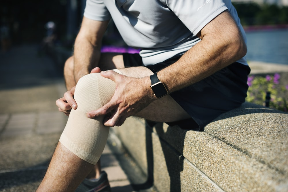 man pressing his knee