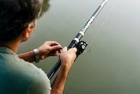 man fishing closeup photography