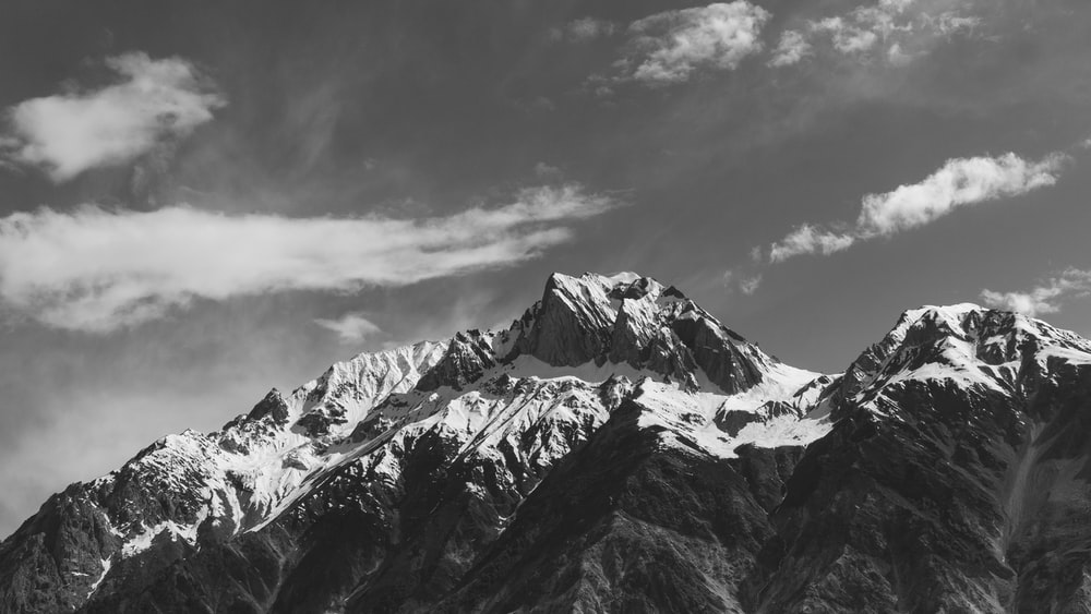 snow covered mountain range in grayscale photography