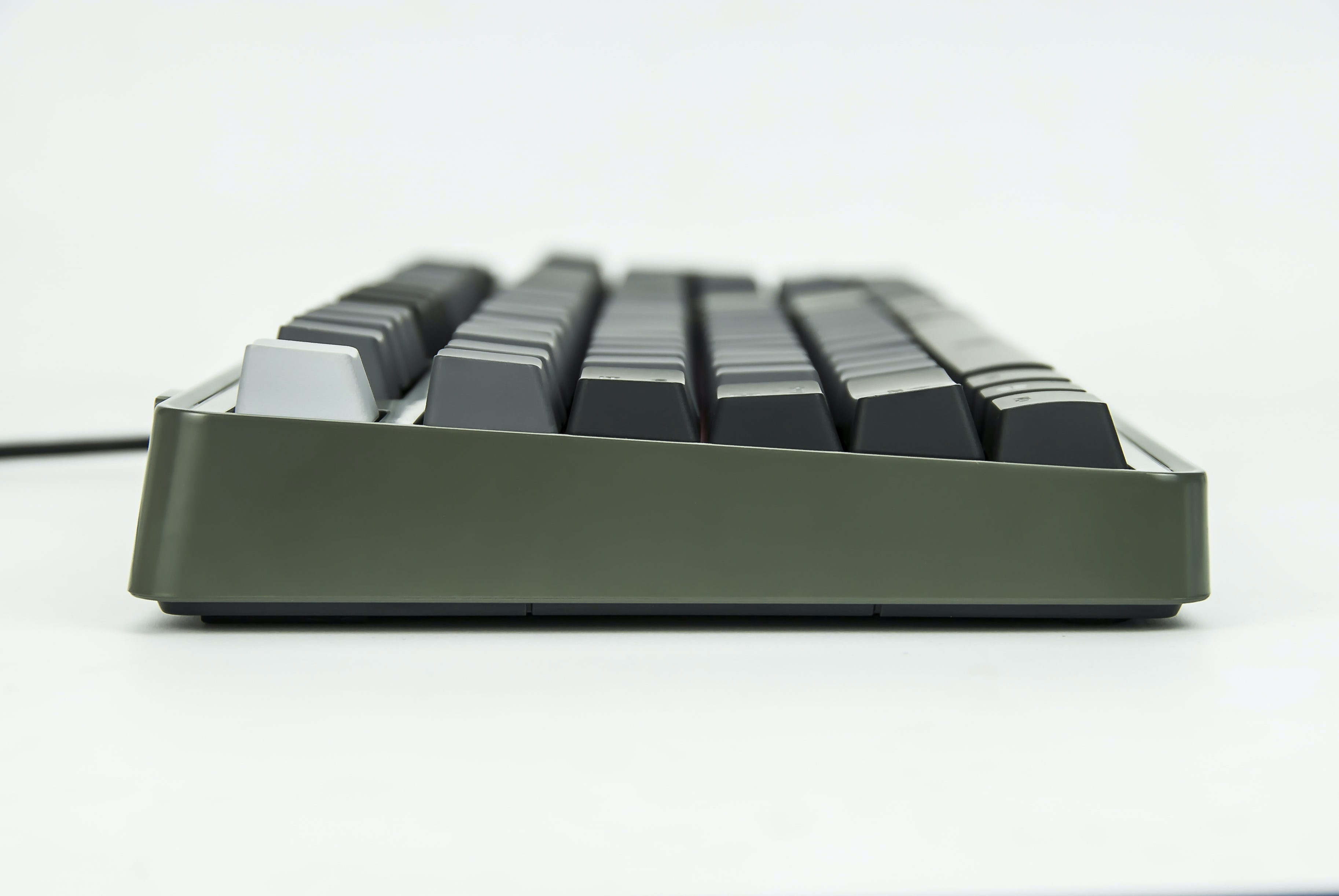 selective focus of black and gray corded computer keyboard