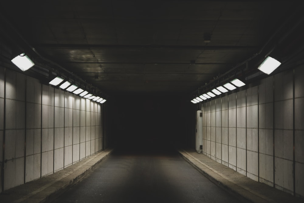 photo of gray tunnel