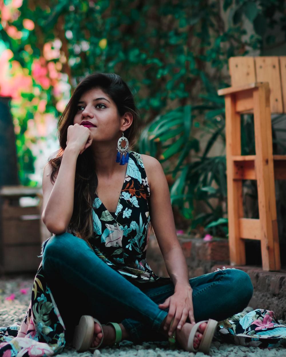 woman sitting on gravel