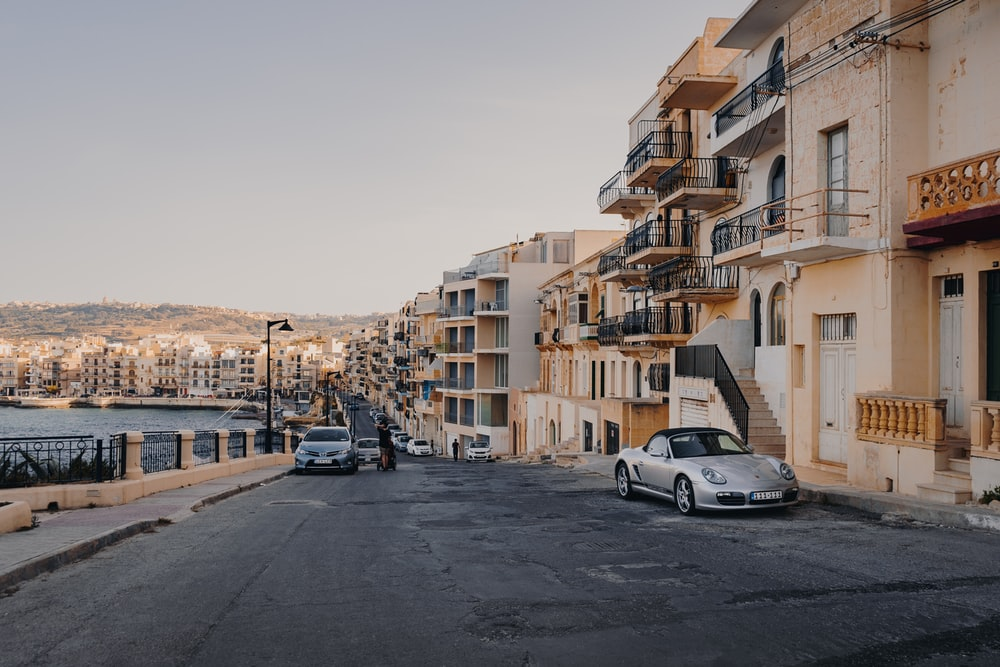 parked car near buildings taken during daytime