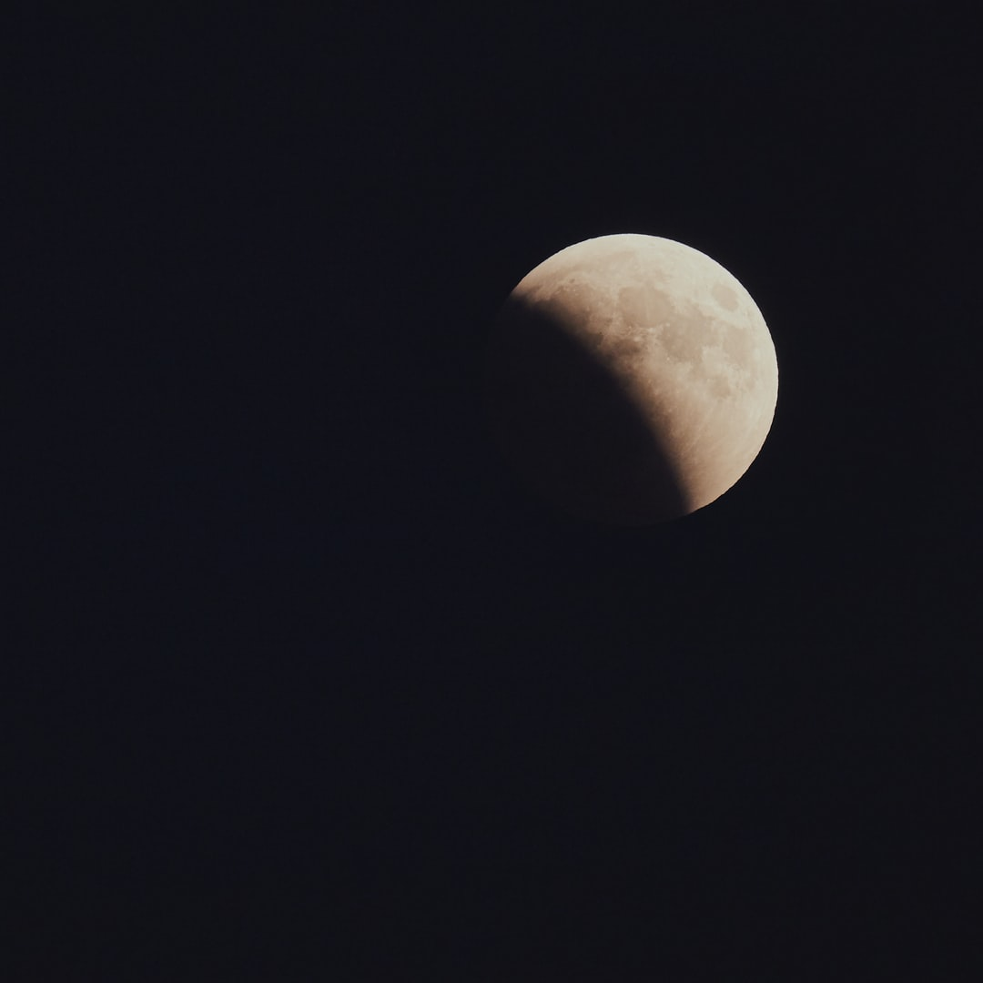 Partial Moon Eclipse 27.7.2018 near Sreser, Peljesac, Croatia  There are more similar photos from this location/site on my web site https://Majco.photography. If you are interested in one of them under an Unsplash license, you can ask me by email to martin@brechtl.com