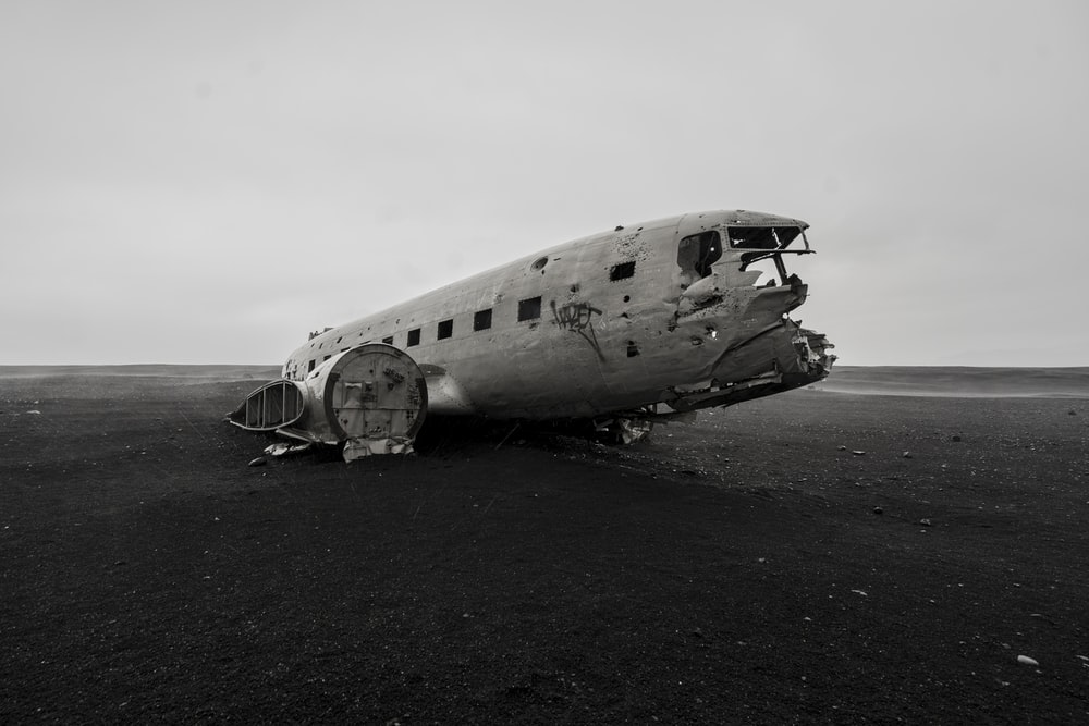 crashed gray airliner