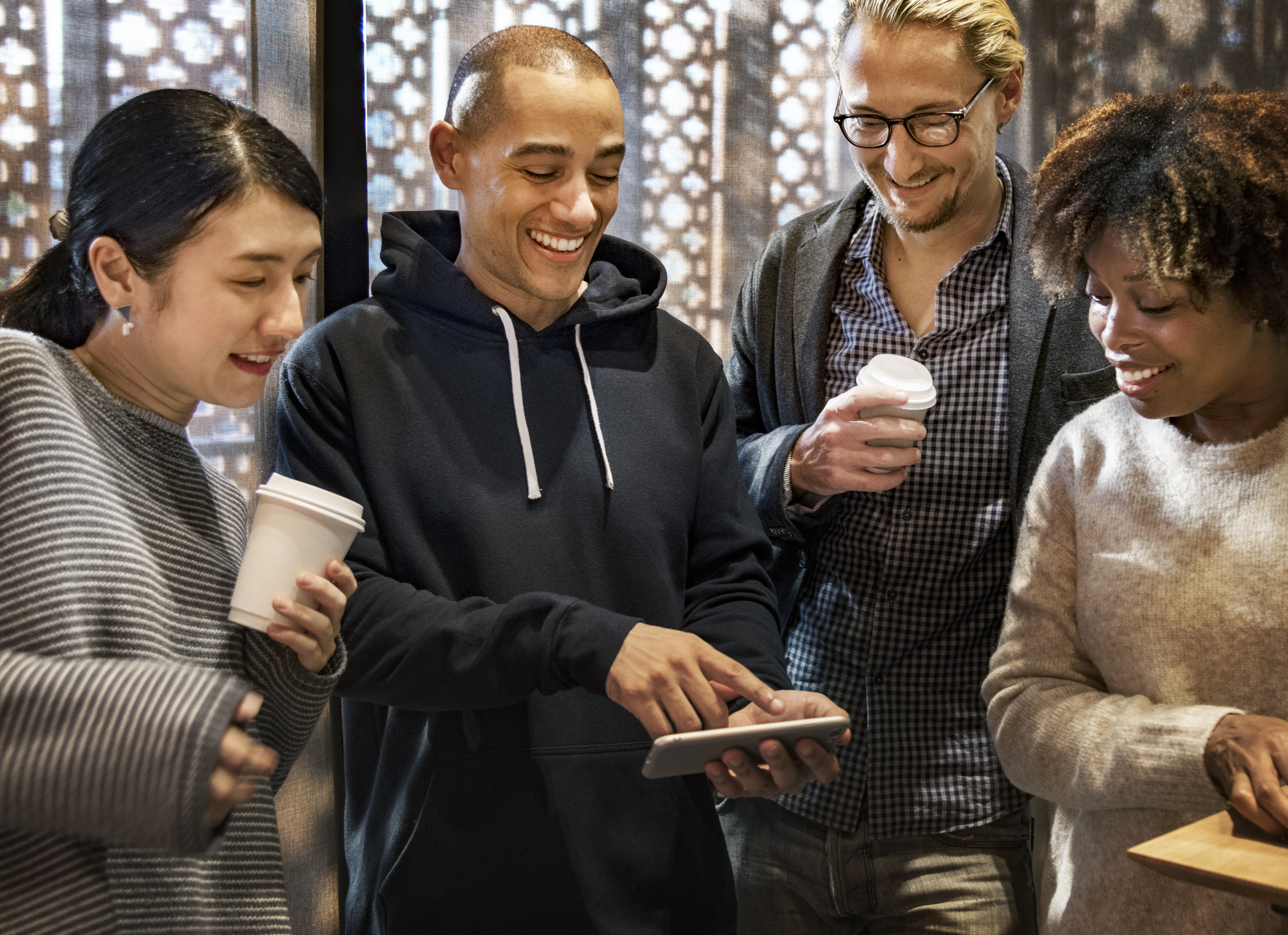 group of people looking at smartphone