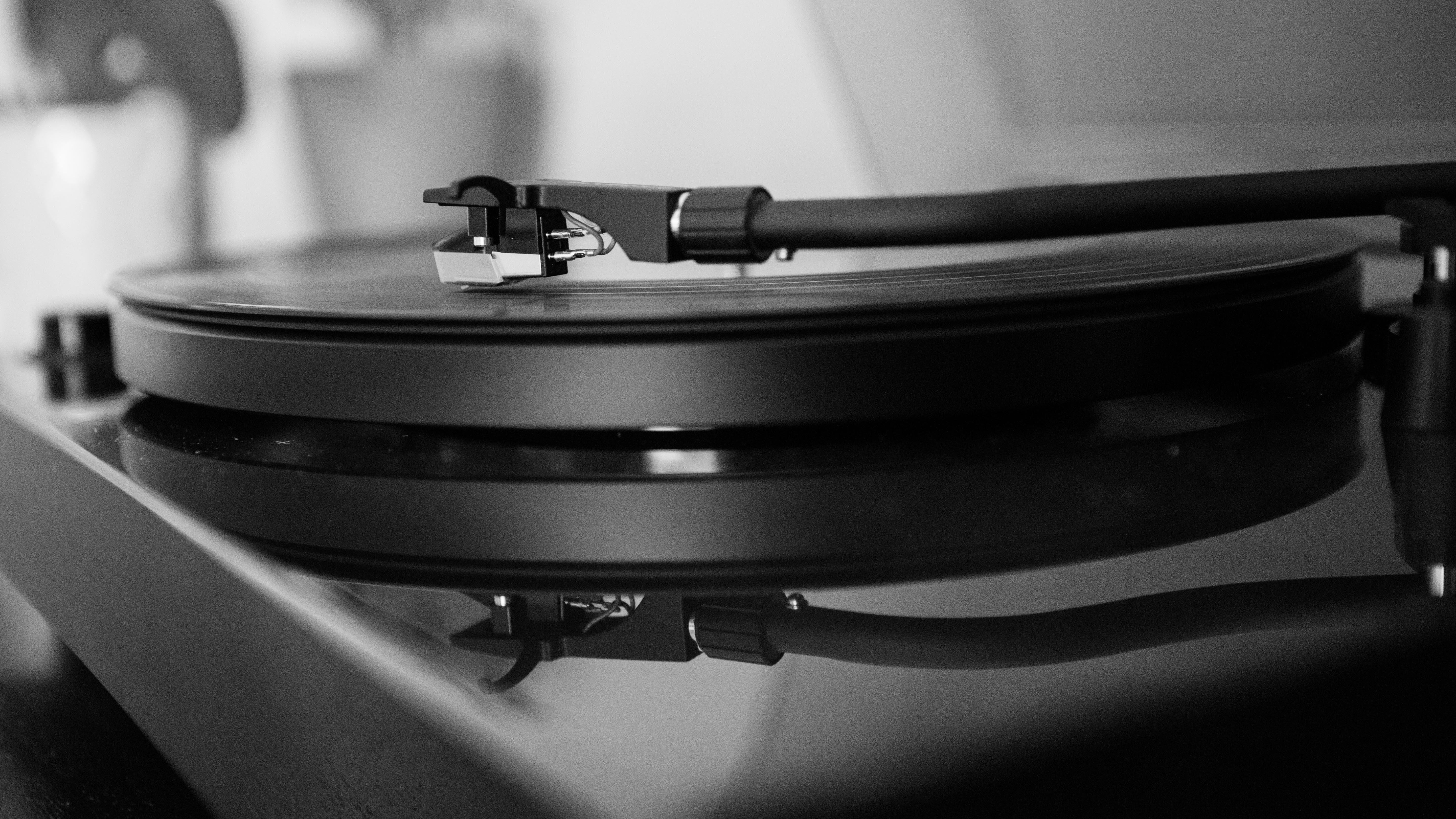 grayscale photo of vinyl player