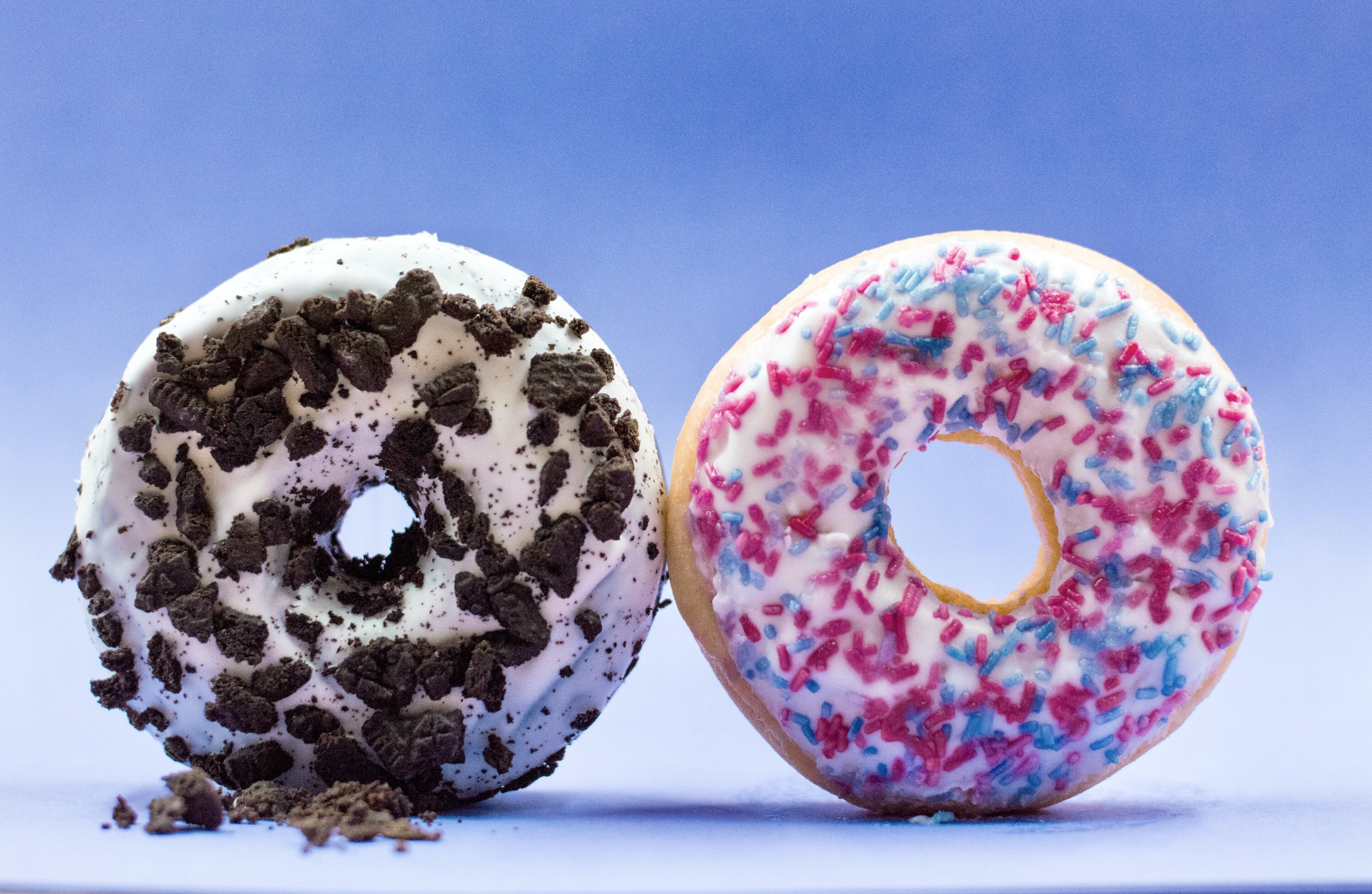 shallow focus photo of two donuts