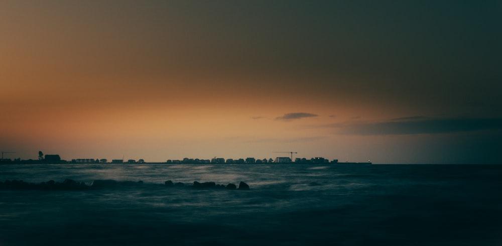 blue ocean during dawn