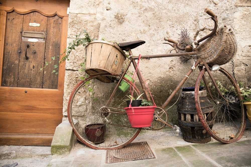 bicycle outside the house during daytime