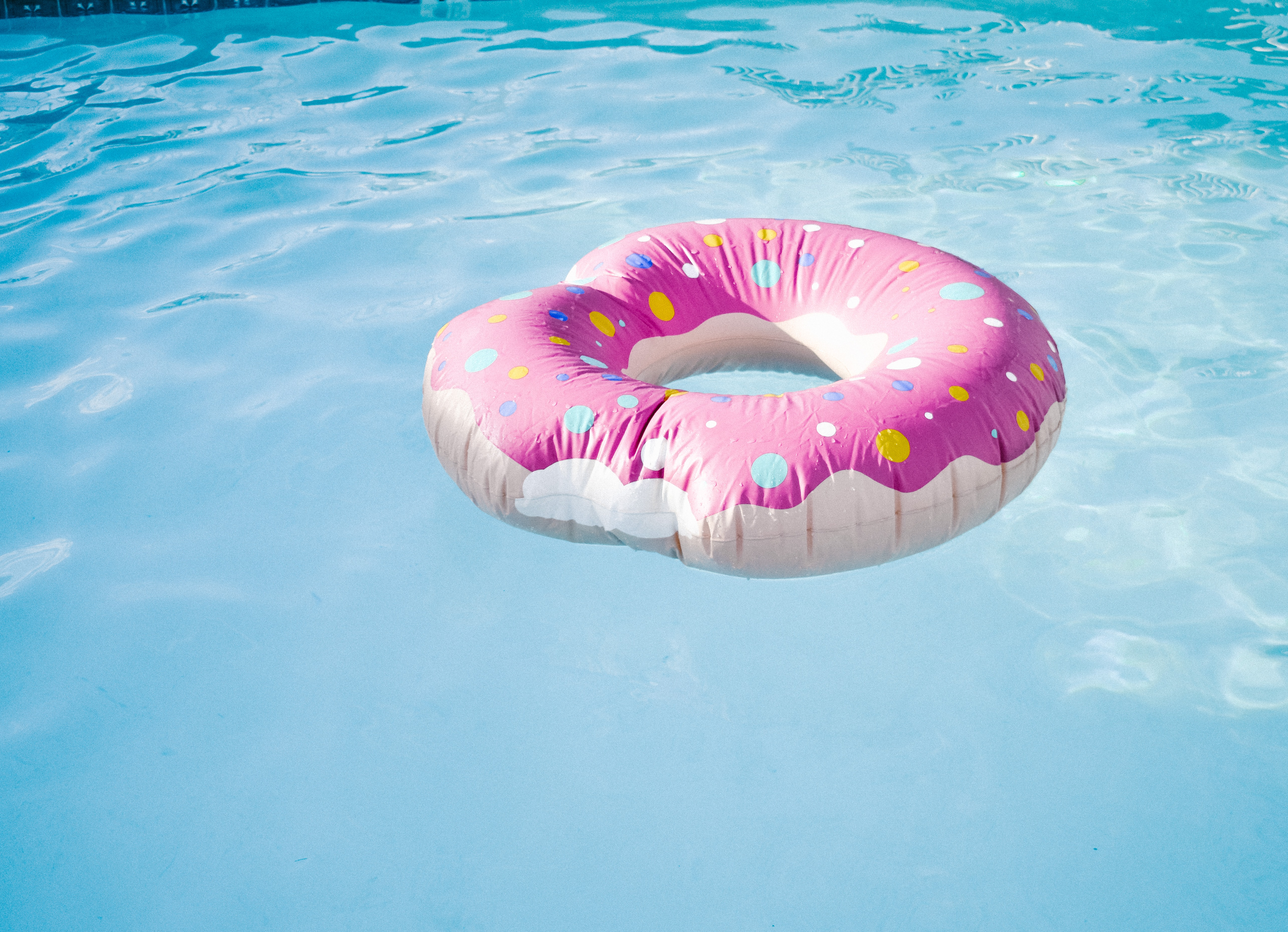 pink coated doughnut floater