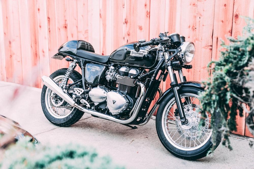 cruiser motorcycle park near fence