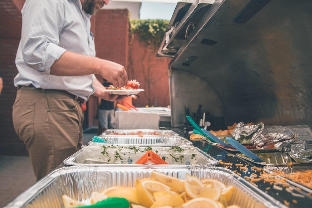 man picking foods on trays