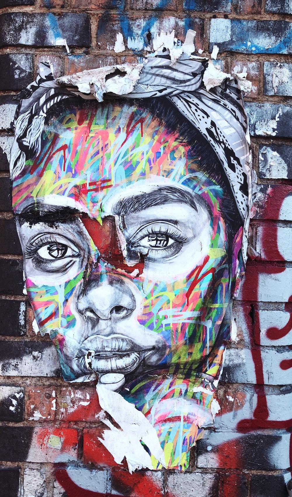 graffiti of woman's face on wall