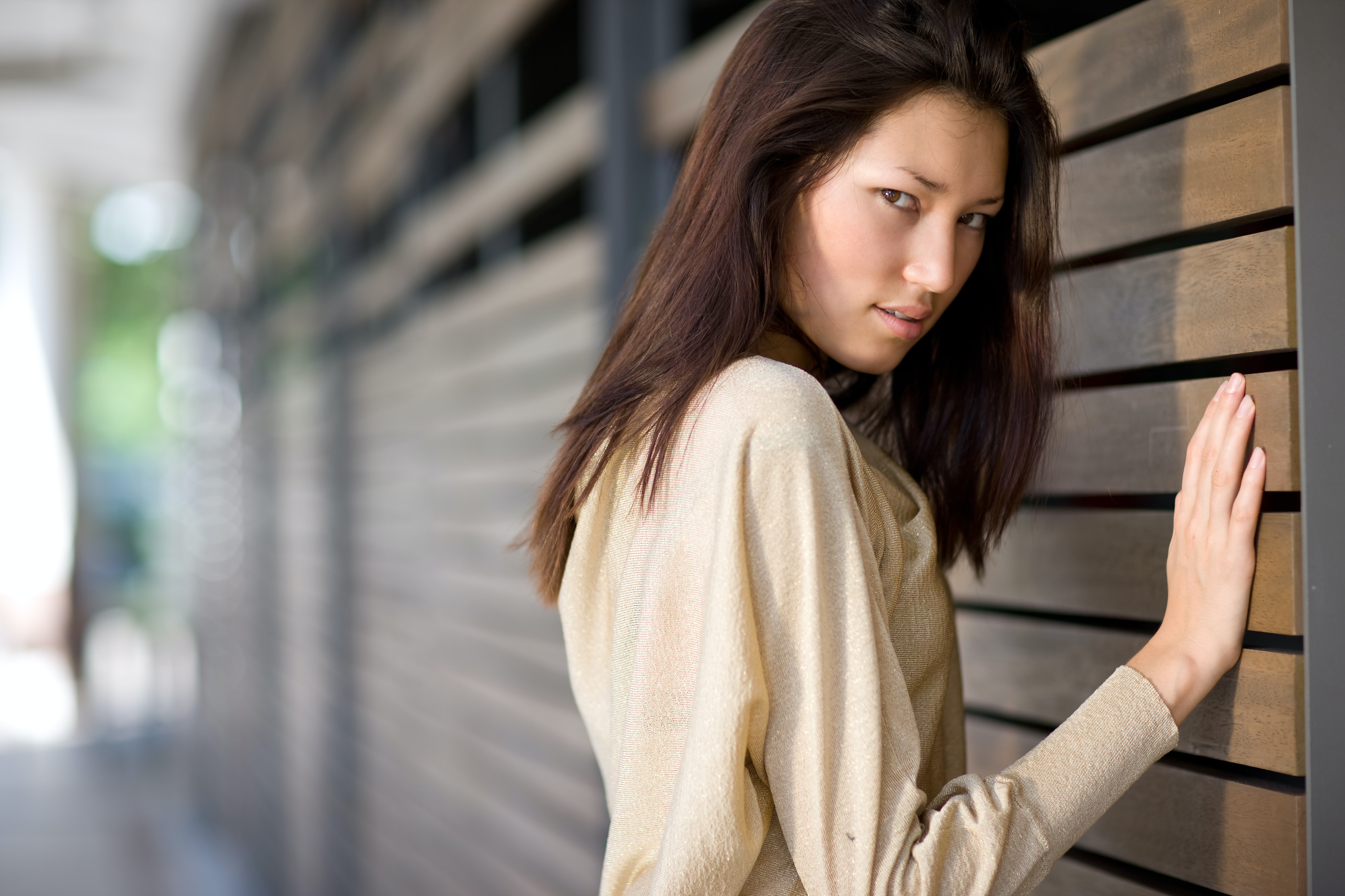 shallow focus photography of woman in beige long-sleeved shirt