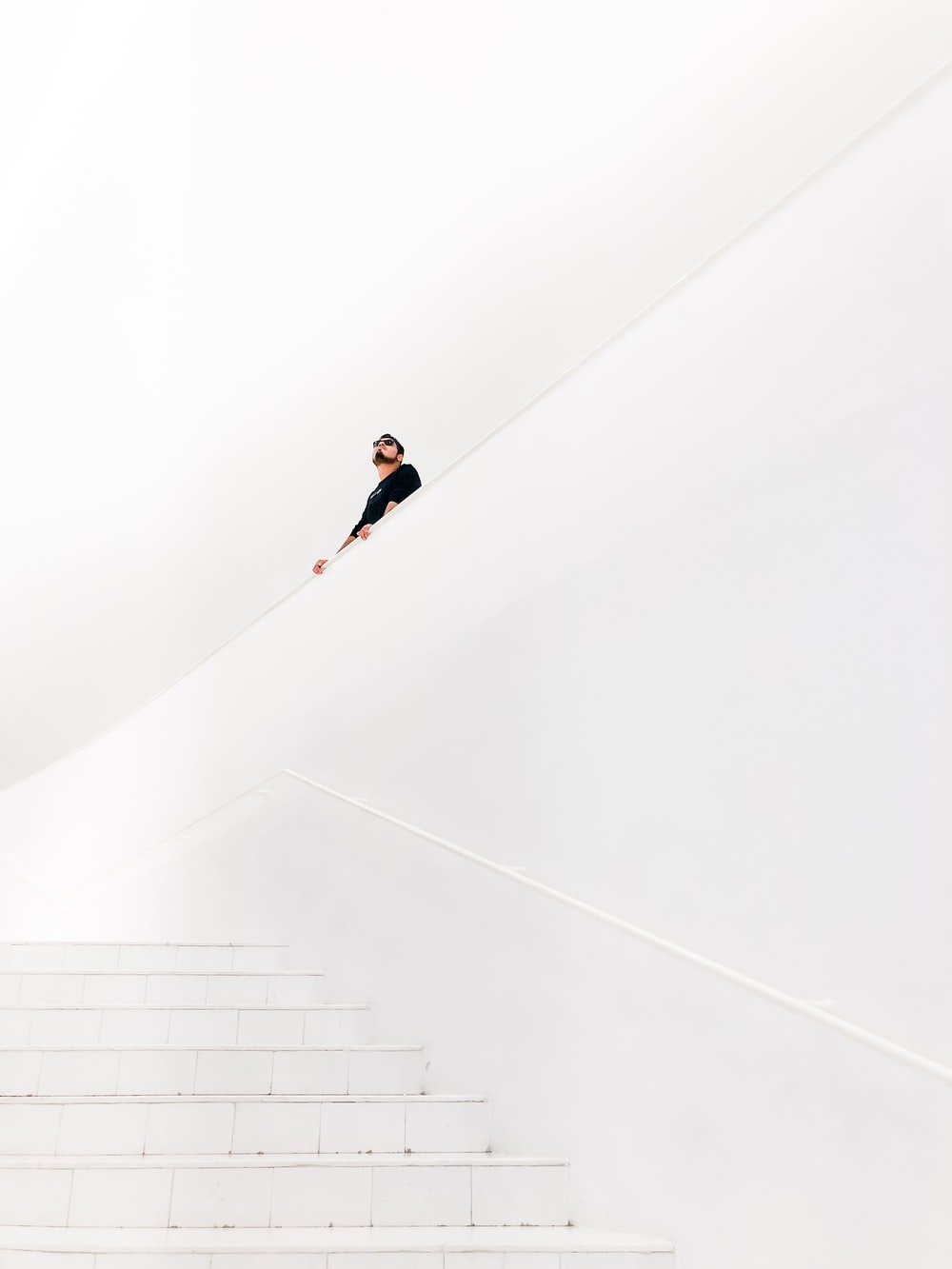 man looking up near stairs