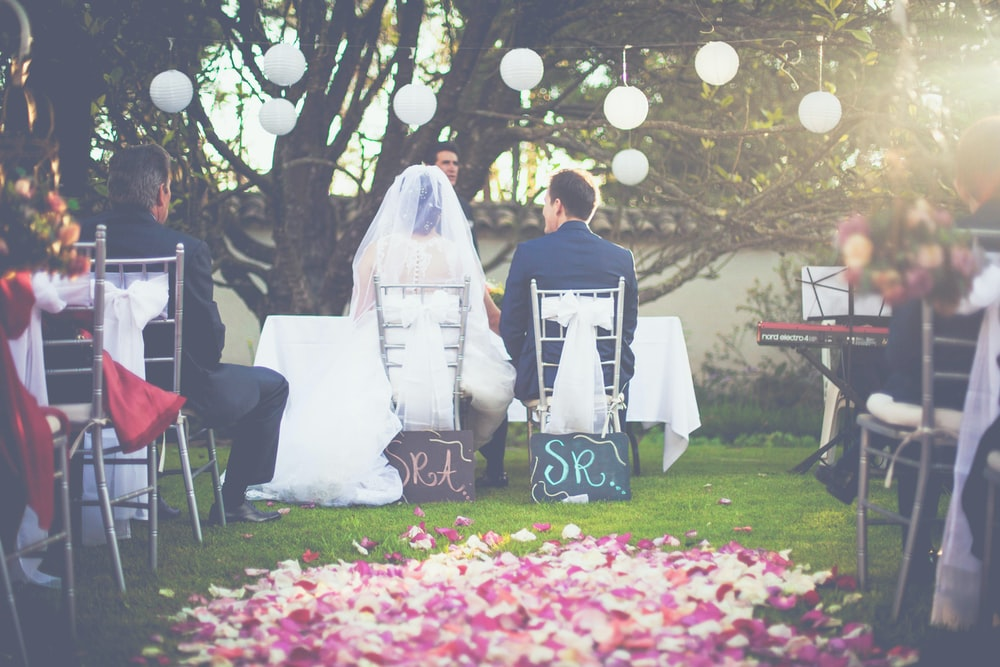 bride and groom having wedding ceremony