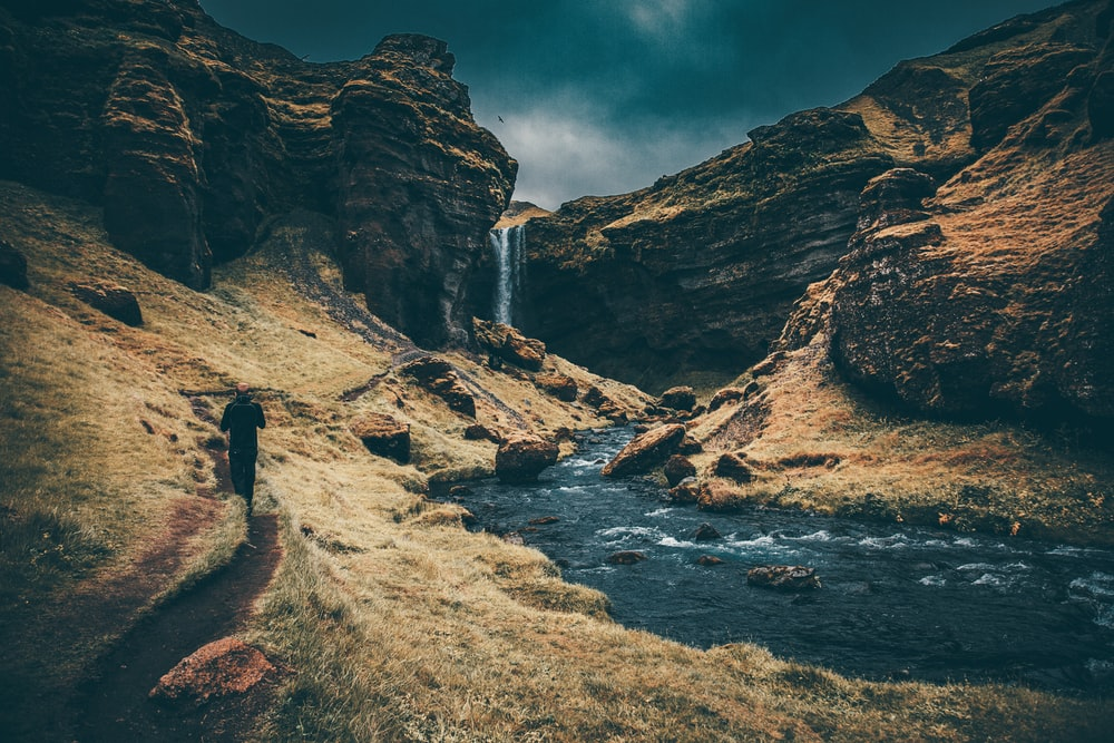 waterfalls surrounded by rock formation