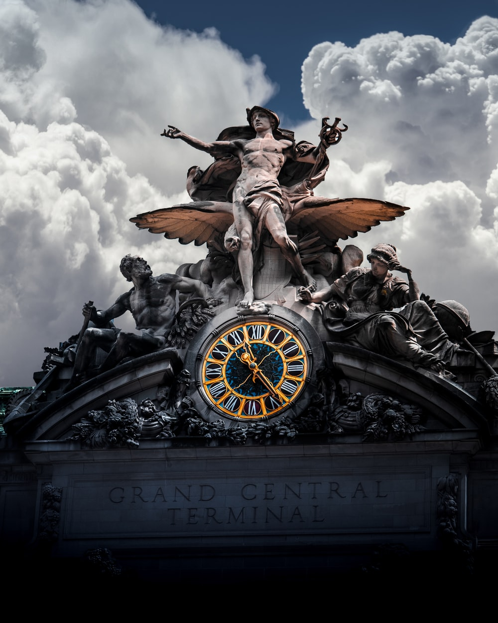 selective color photo of Grand Central Terminal statue