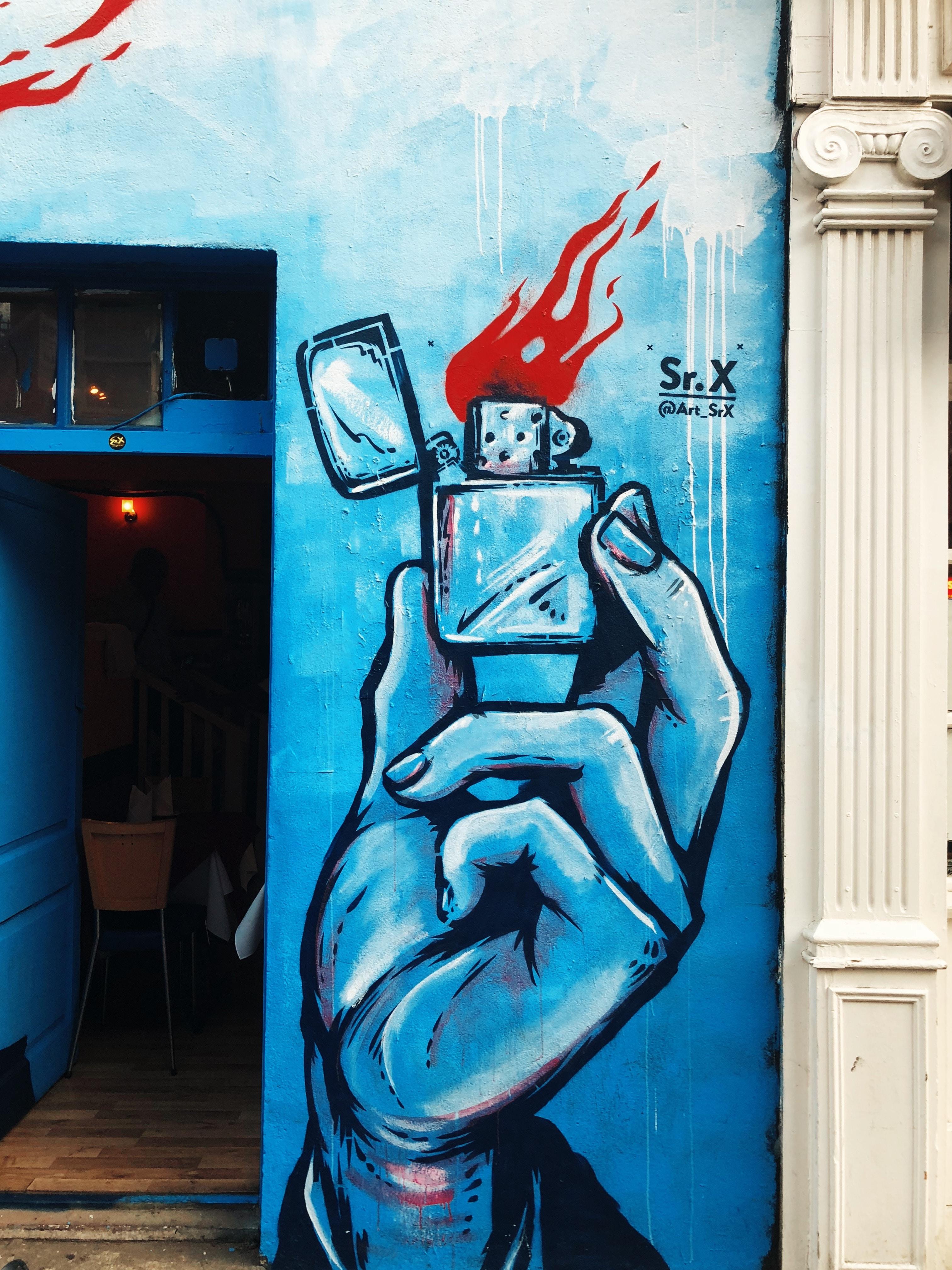 holding flip lighter graffiti
