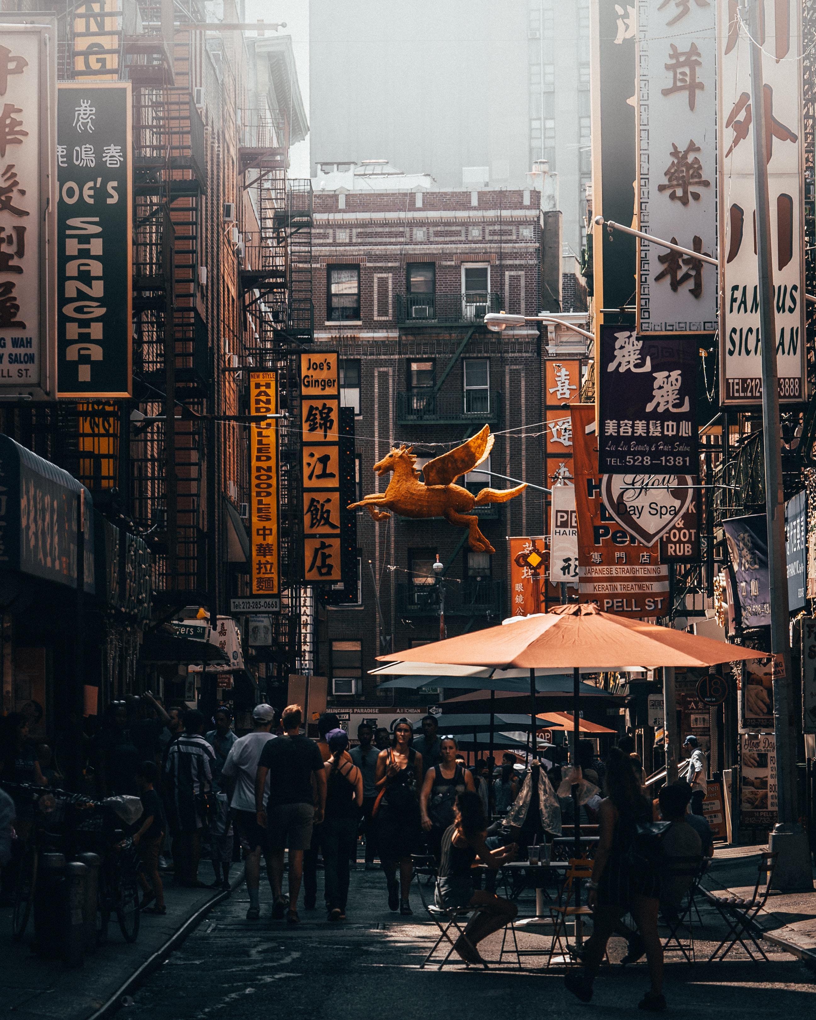 group of people walking between buildings