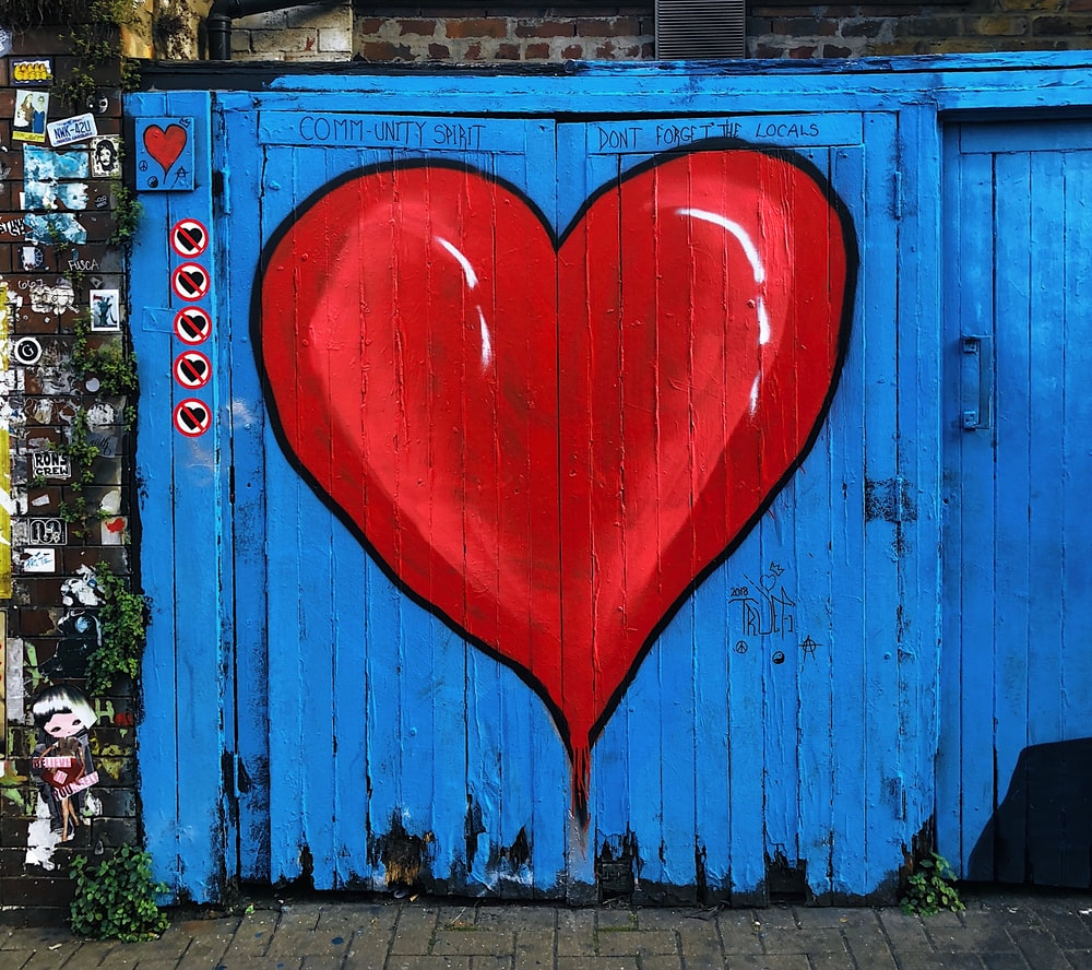 blue wooden gate with a red heart painted on it