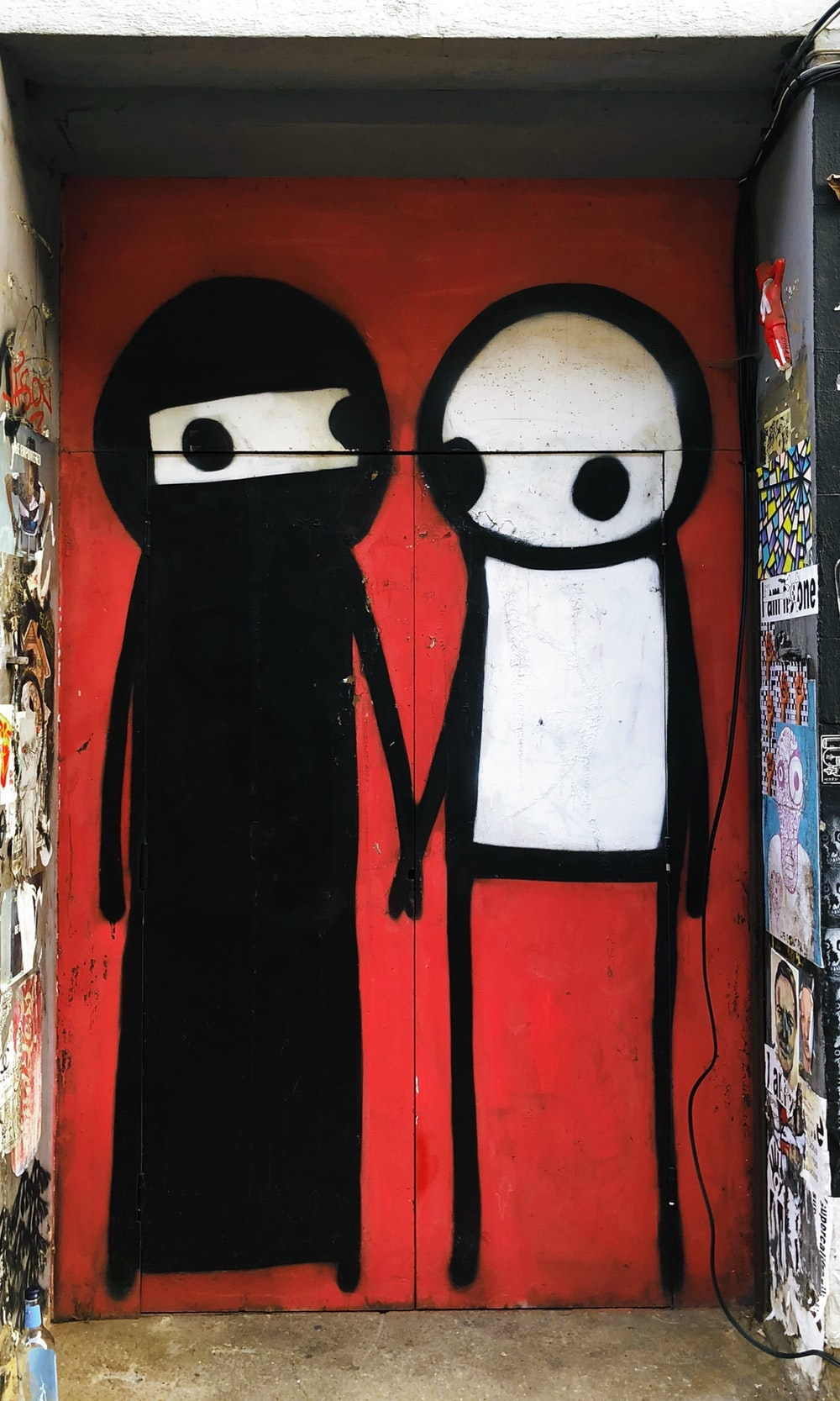 two person holding hand graffiti