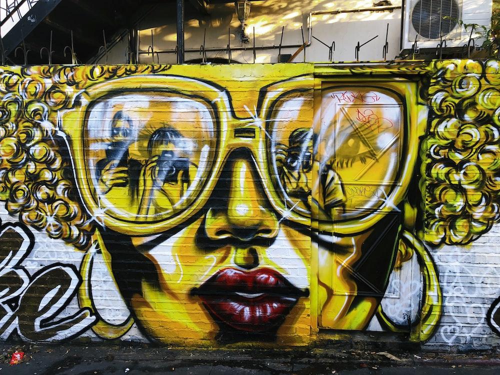 woman wearing sunglasses mural painting