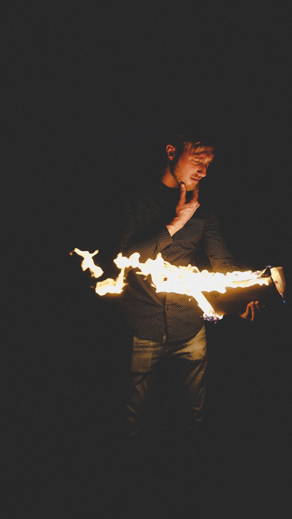 man playing with fire