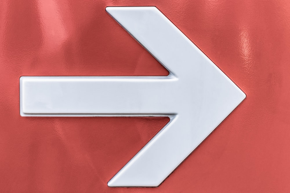 white arrow sign of wall