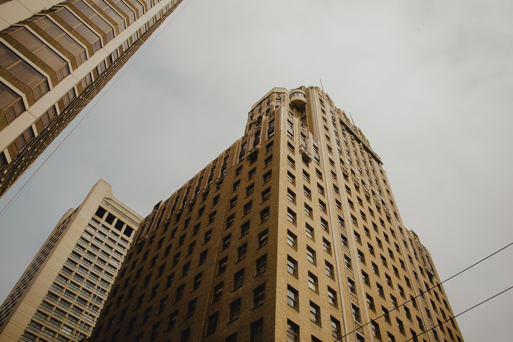 low angle view photogrpahy of brown building