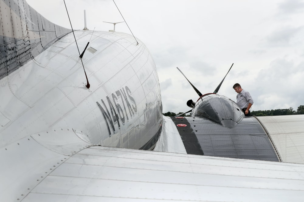 close up photo of white and gray private plane