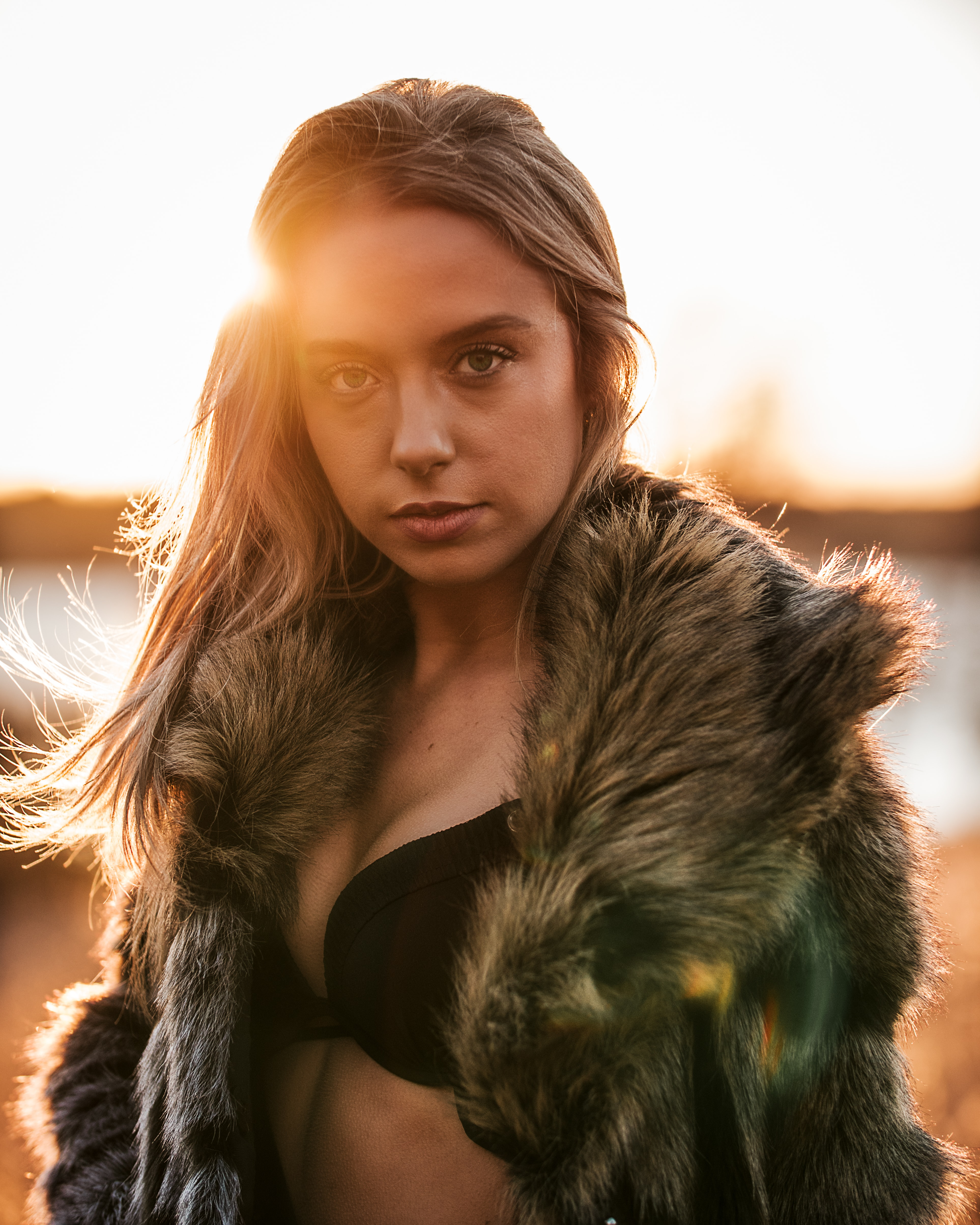 selective focus photography of woman wearing black brassiere and fur coat