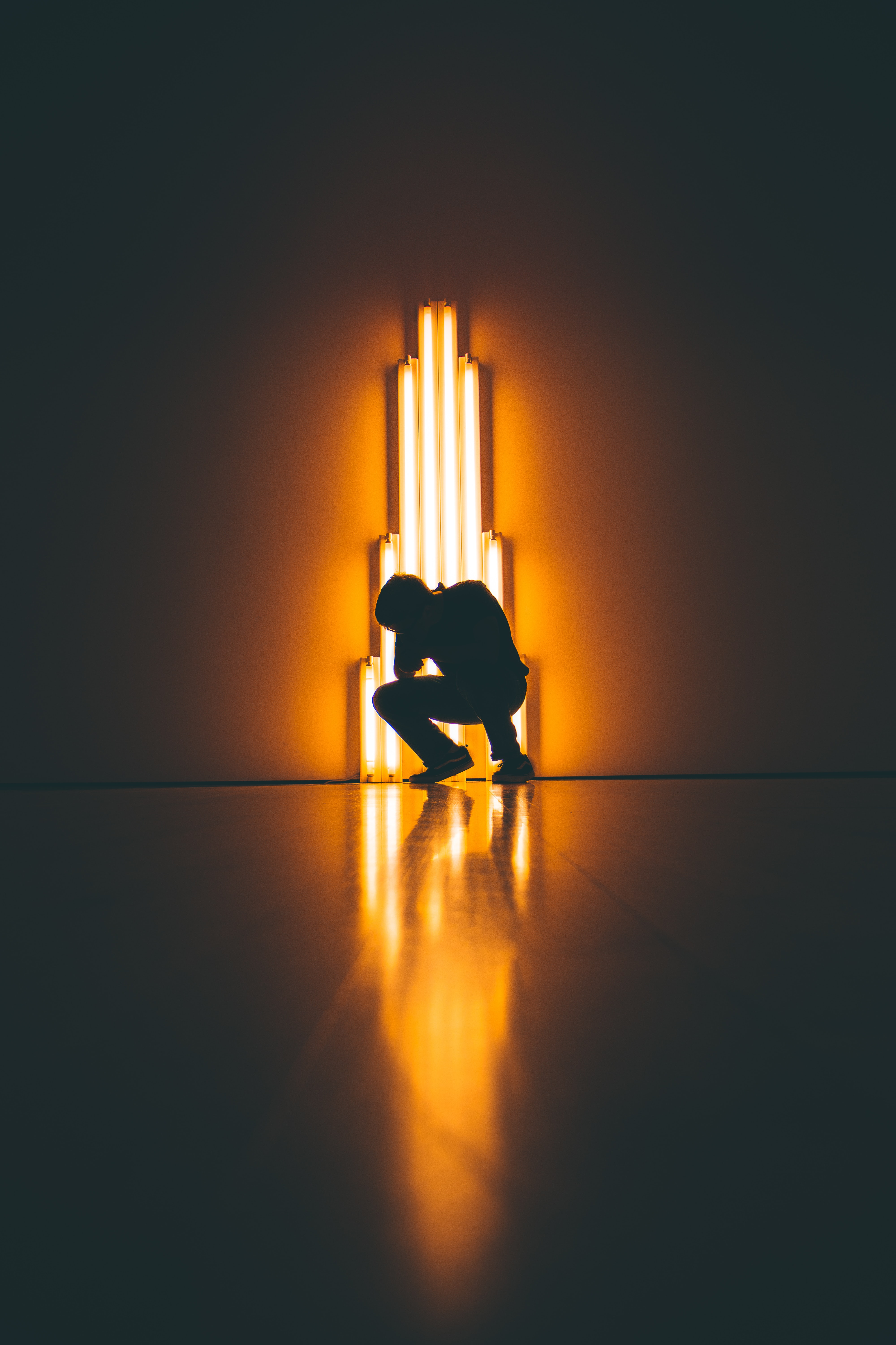 silhouette of man crouching