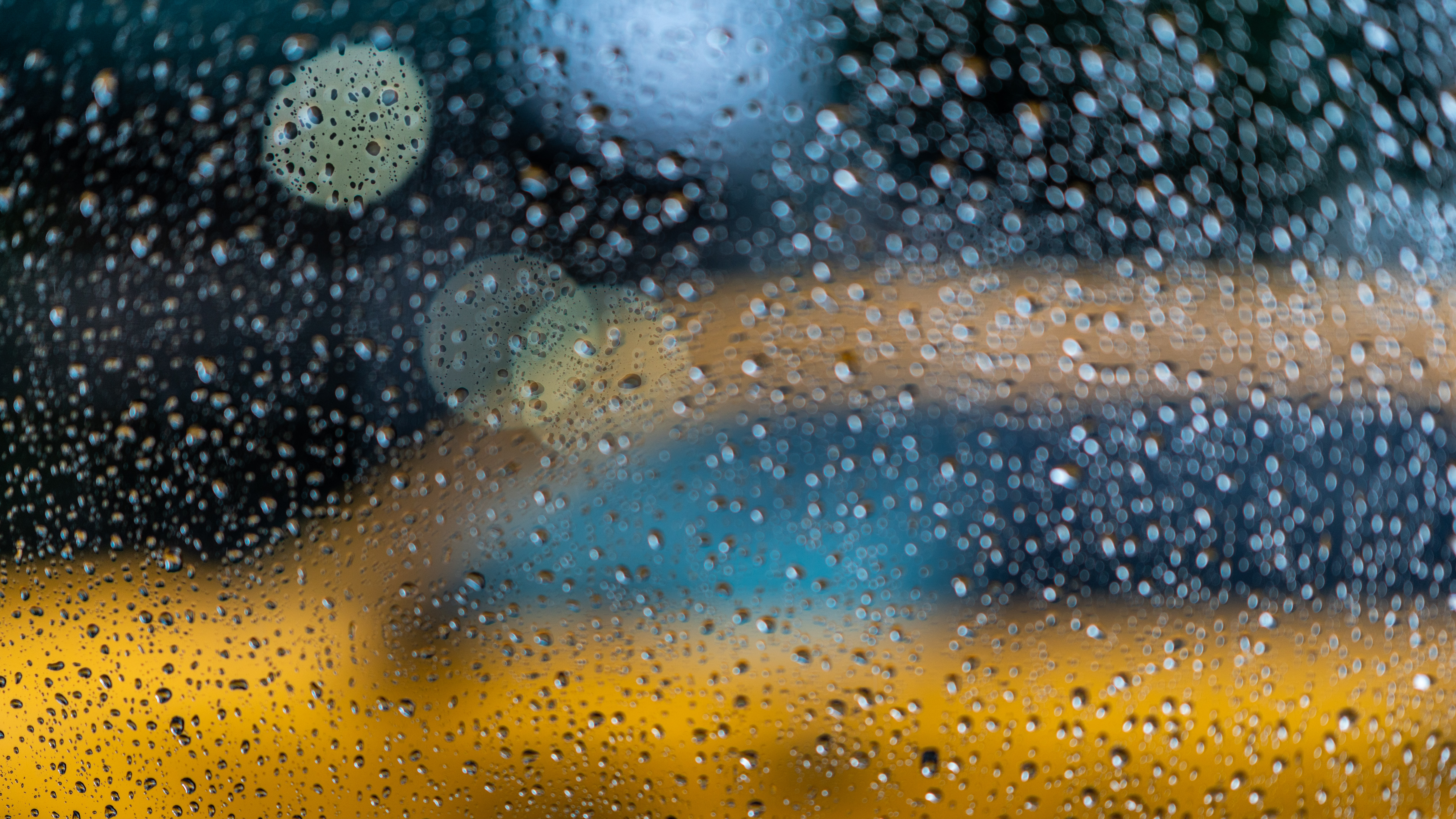 bokeh photography of glass window with water dew