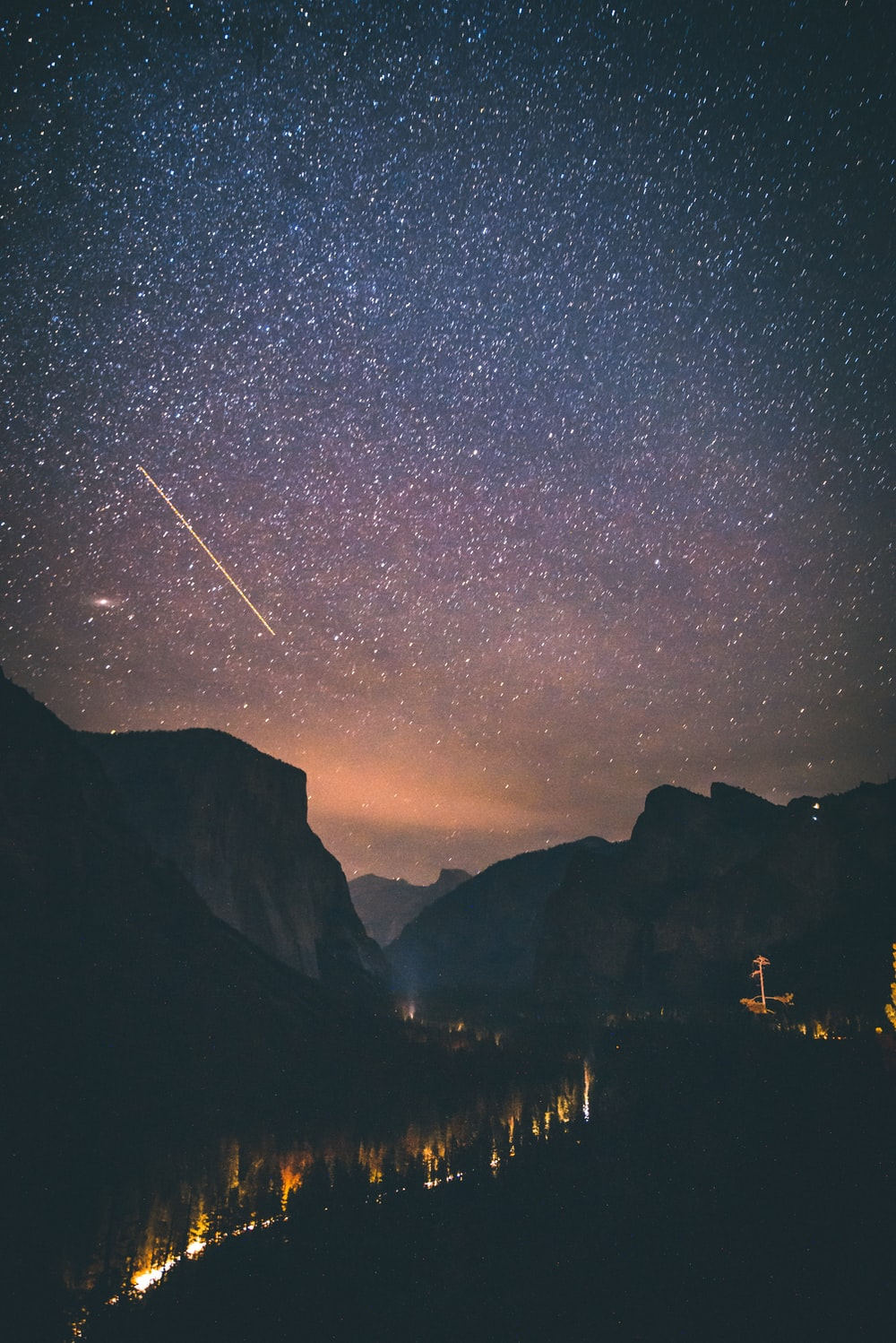 shooting star above mountains