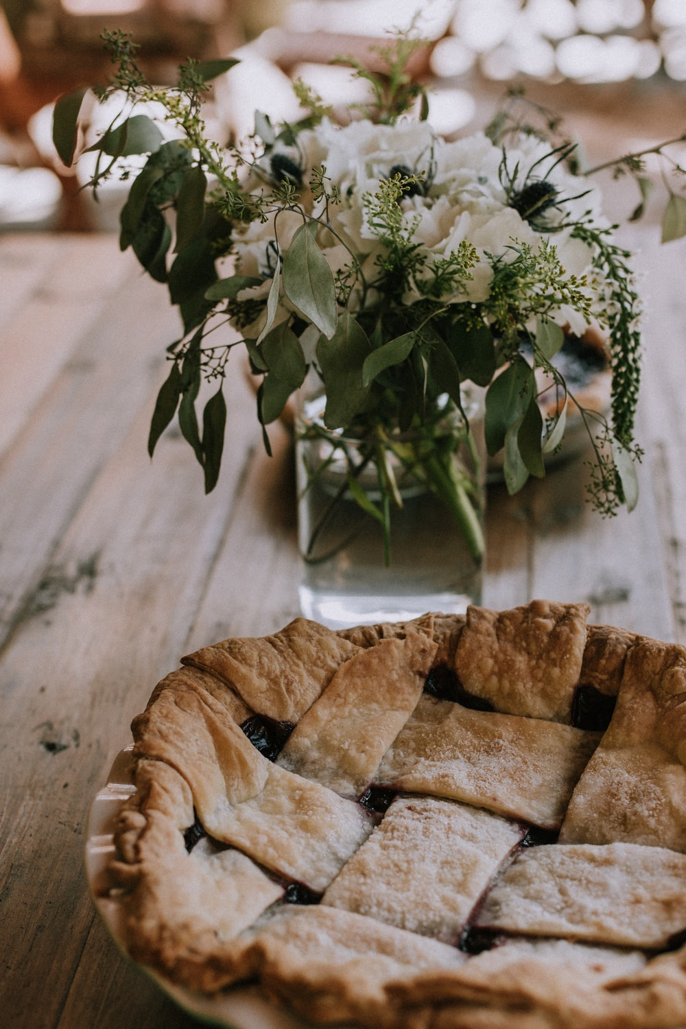 selective focus photography of baked bread beside white petaled flower