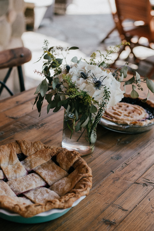 focus photography of flowers between pies