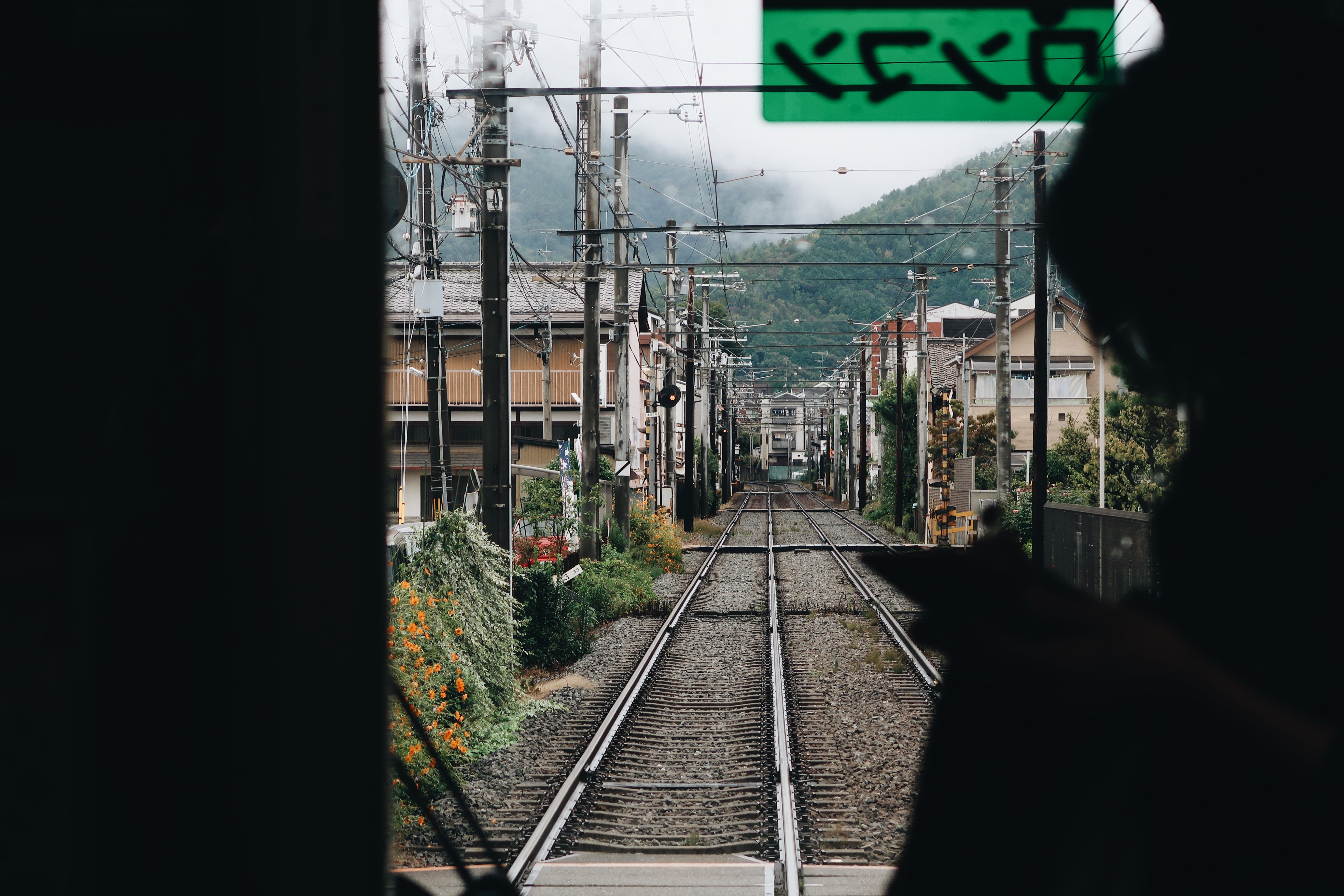 photo of train traveling on town
