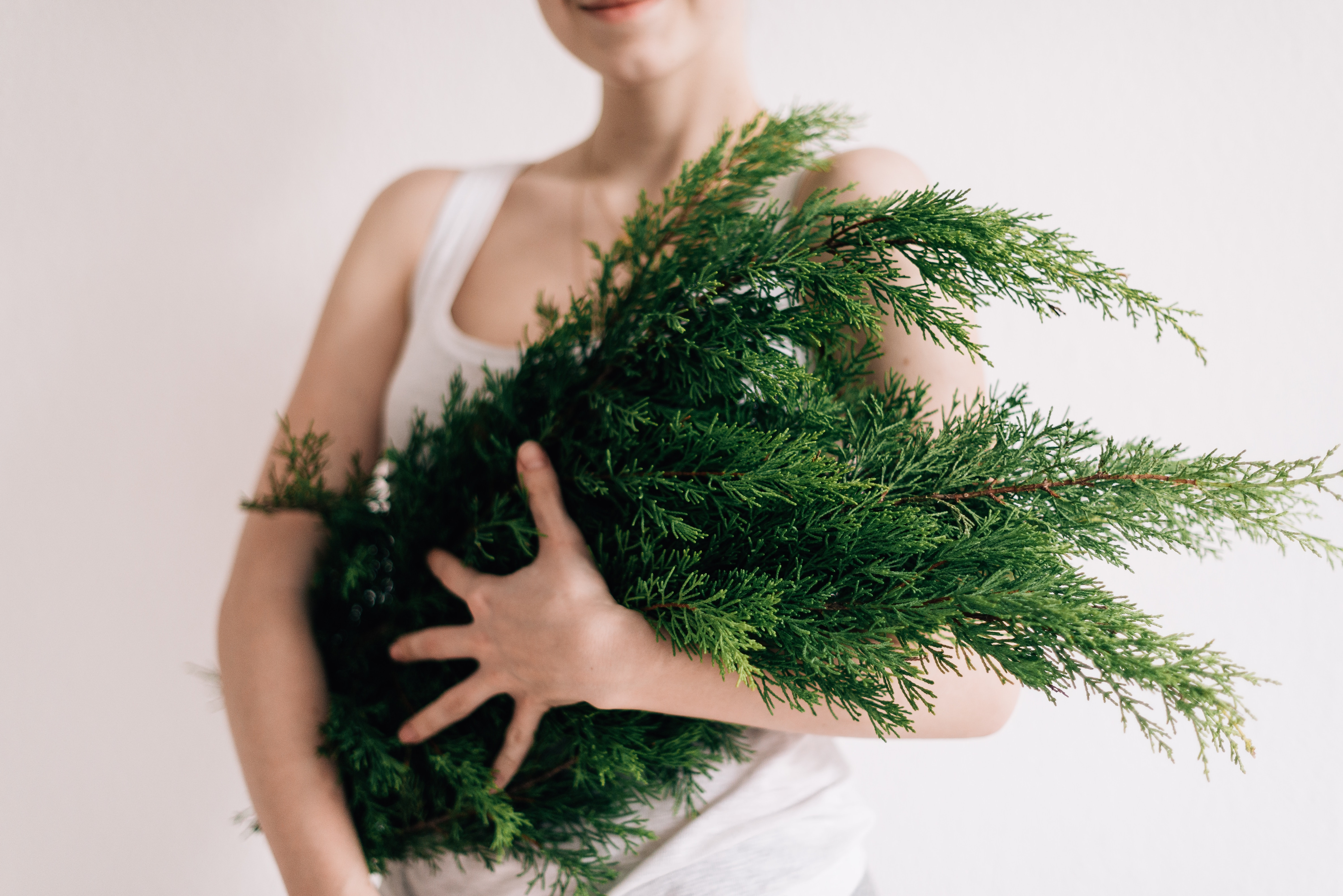 woman holding green leafs