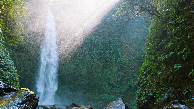 sunlight passing through waterfall during daytime