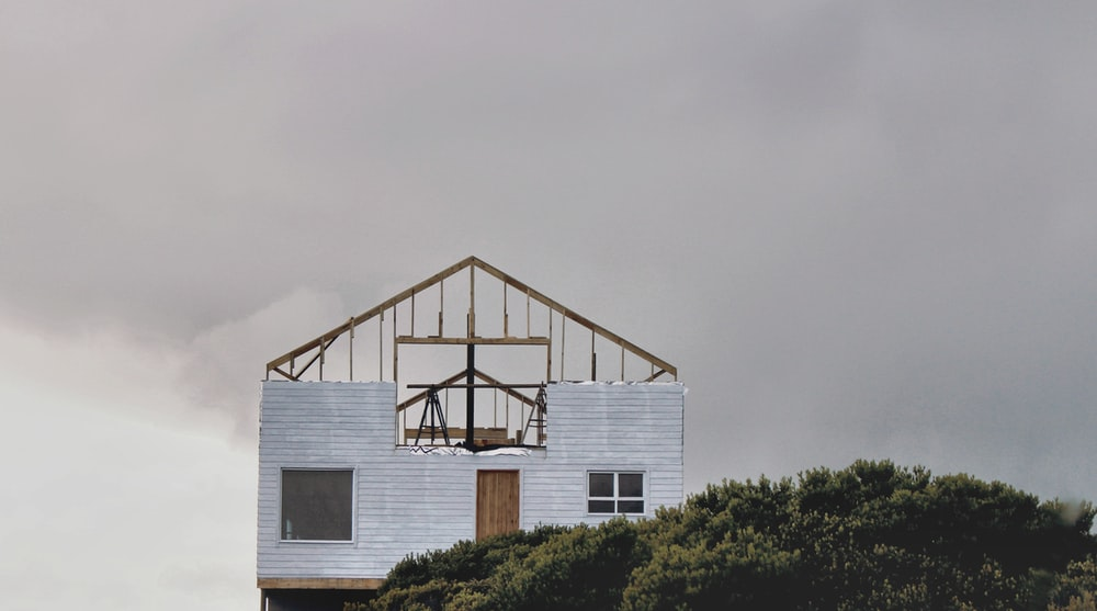 low-angle photo of house near tree