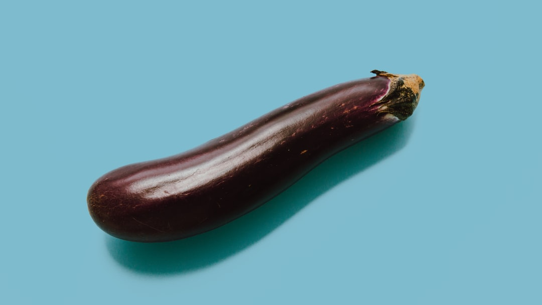 Aubergine is also knpwn as eggplant in American English by Charles Deluvio Unsplash.