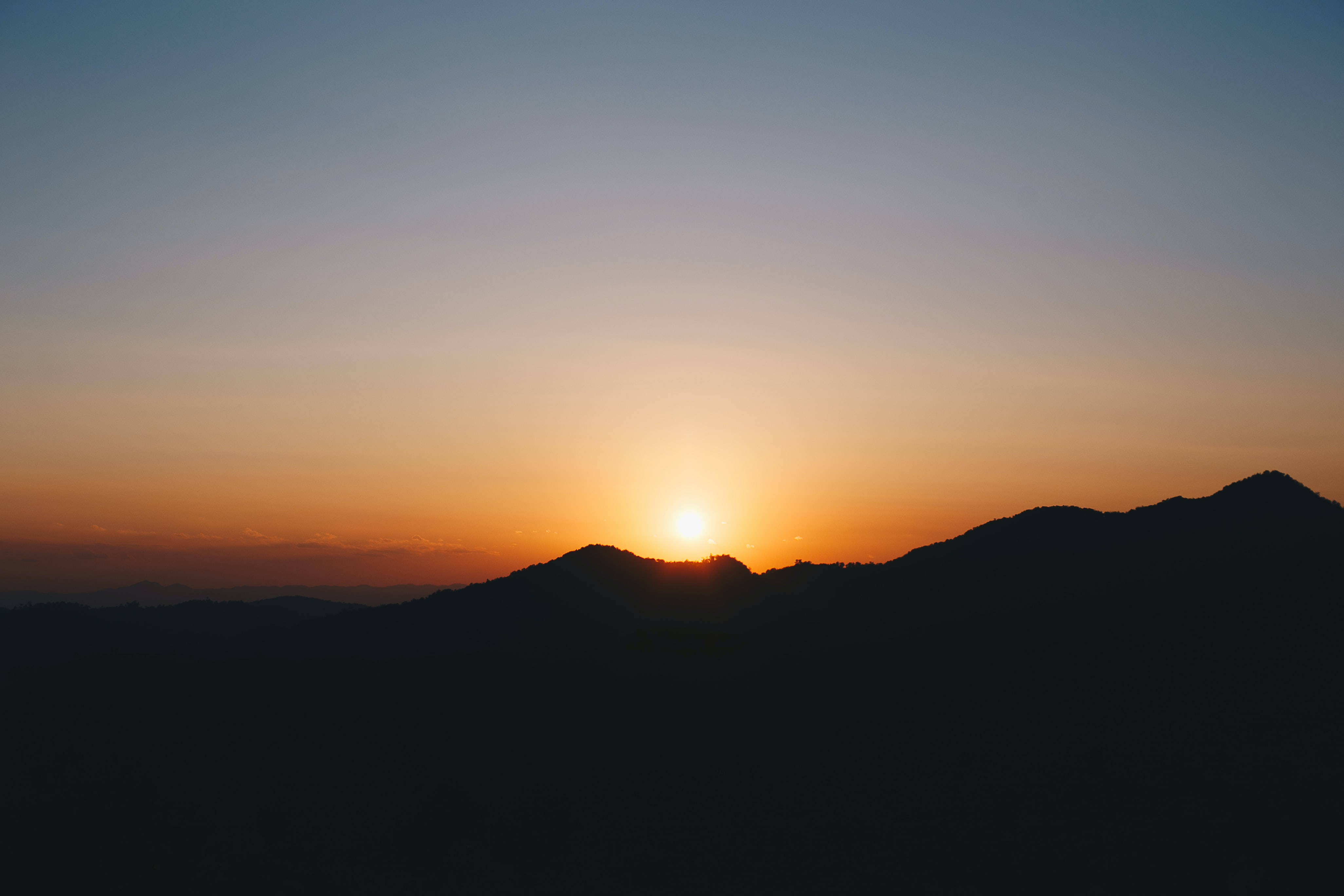 mountain silhouettes during golden hour