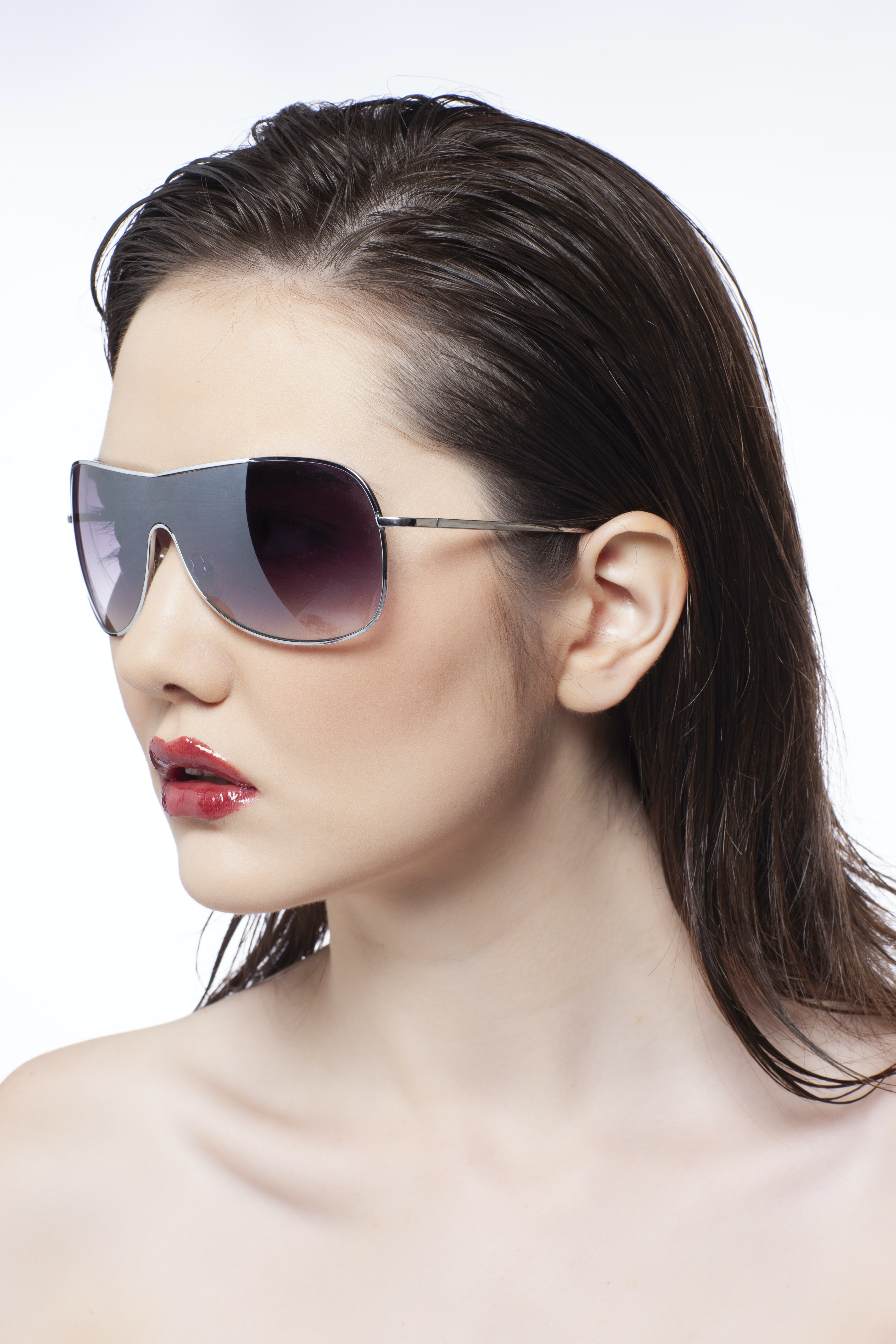 portrait of woman wearing sunglasses with white background