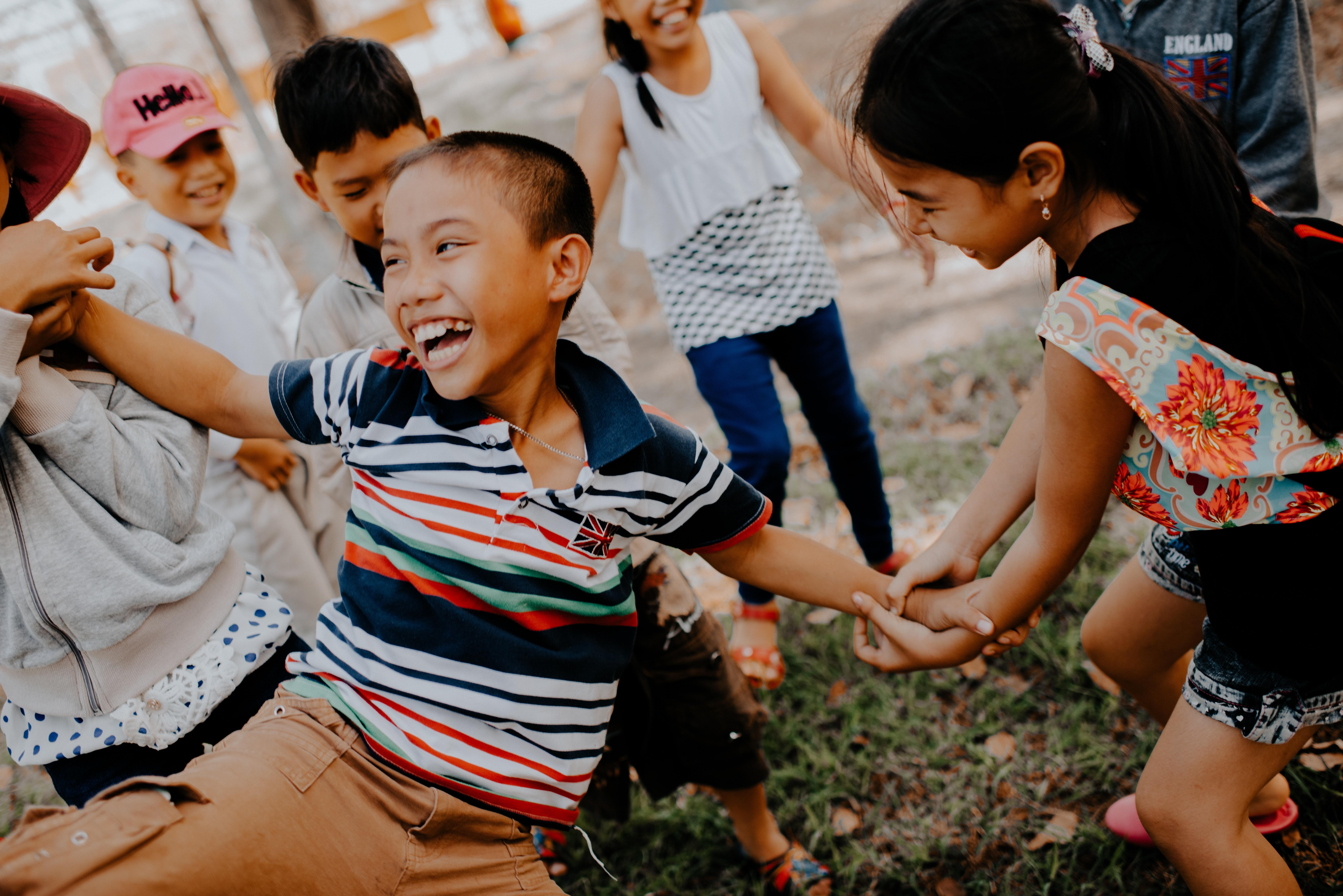 children playing on grass field