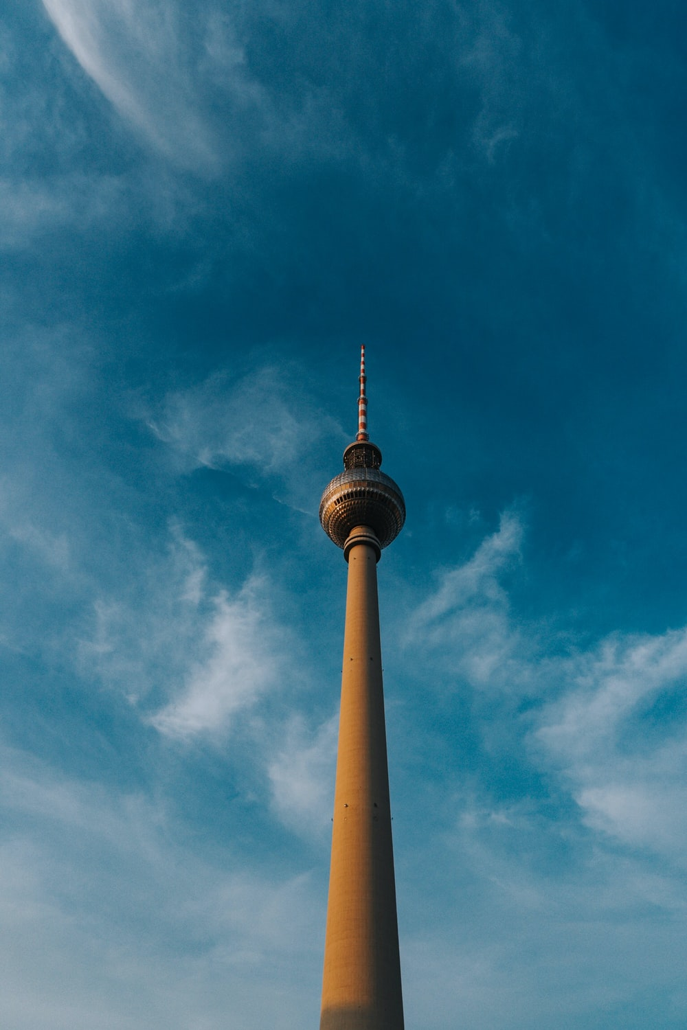 low angle photography of tower under blue sky
